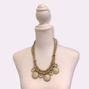 Marble statement necklace in golden setting